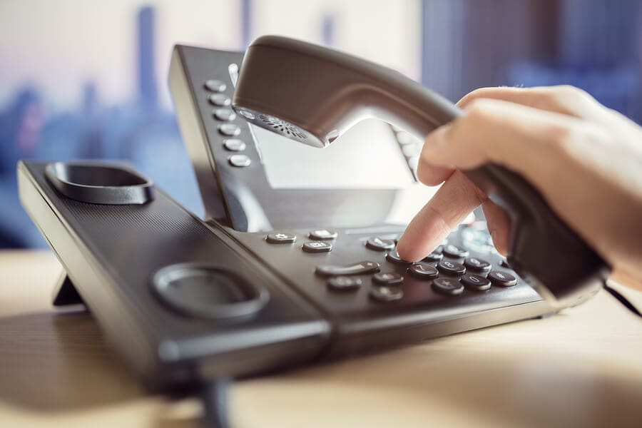 Desk telephone being dailed